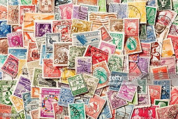 Background of old, canceled Postage Stamps. XXXL