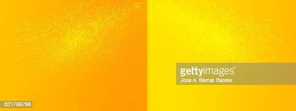 Background  of yellow and orange color with msalpicaduras from water drops to pressure
