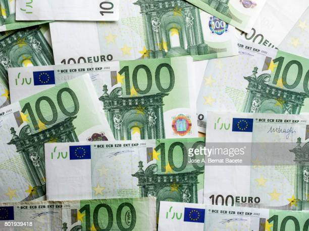 background shot of various paper currencies from 100 euros - euro symbol stock photos and pictures