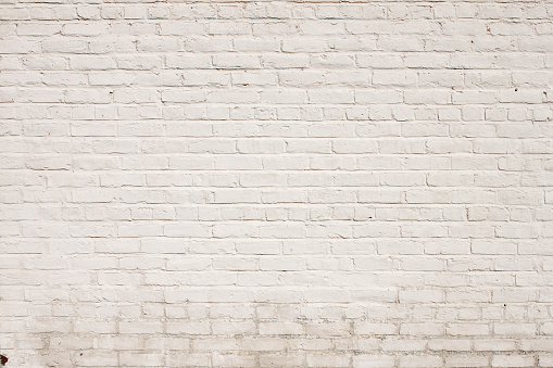 background texture of a Brick Exterior Wall Painted White 905694696