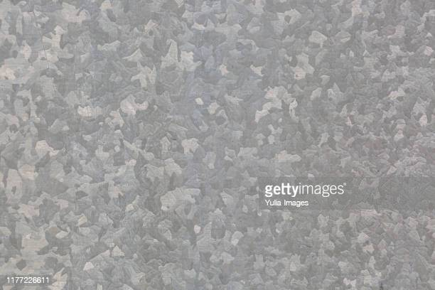 background texture of a raw galvanised metal sheet - 亜鉛 ストックフォトと画像