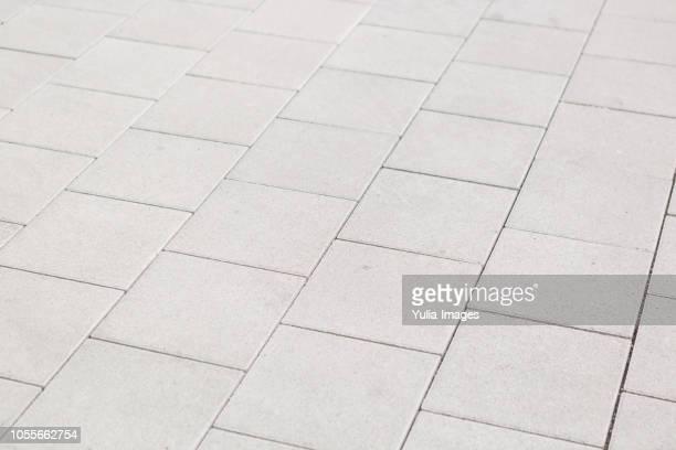 background texture of square white paving tiles - gehweg stock-fotos und bilder