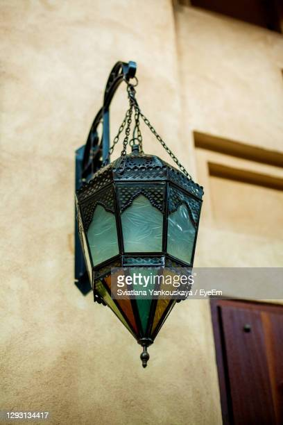 background traditional arabic lamps on a stone wall, close-up - ramadan decoration stock pictures, royalty-free photos & images