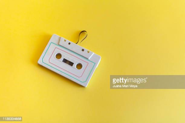 background vintage of a cassette, of the years 80-90. the background is yellow - pop music stock pictures, royalty-free photos & images