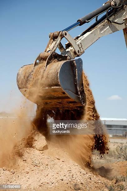 Backhoe Dumping a Scoop of Dirt