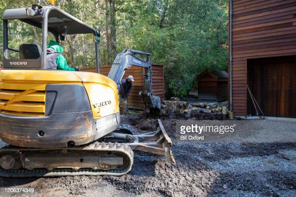 backhoe excavating dirt on construction site - istock images stock pictures, royalty-free photos & images