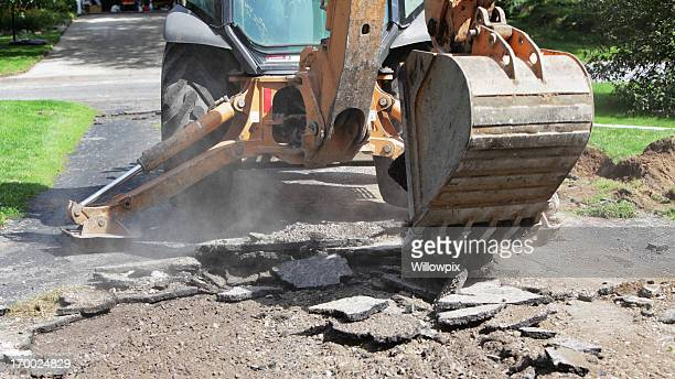 backhoe excavator demolishing old residential driveway - digging stock pictures, royalty-free photos & images