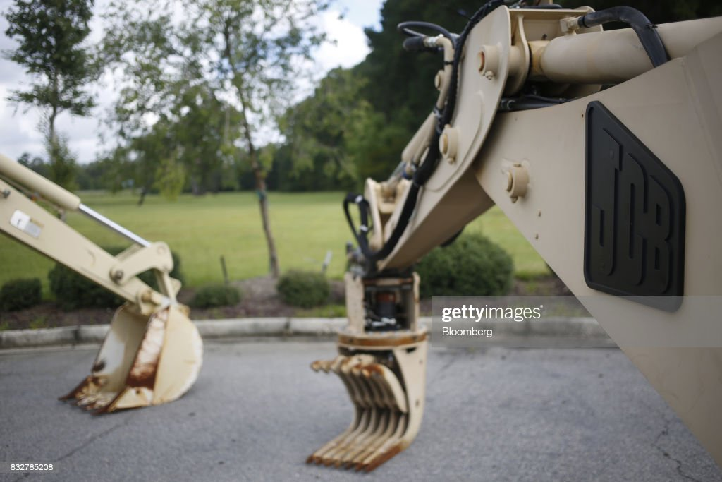 Backhoe loader construction vehicles sit on display outside the JC Bamford Excavators LTD. (JCB) manufacturing plant in Pooler, Georgia, U.S., on Friday, Aug. 11, 2017. The Federal Reserve is scheduled to release industrial production figures on August 17. Photographer: Luke Sharrett/Bloomberg via Getty Images