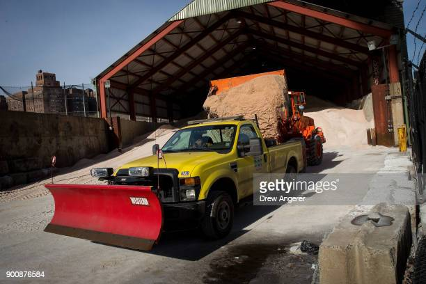 Backhoe loads a New York City Department of Transportation truck with road salt at a storage depot on the Lower East Side, January 3, 2018 in New...