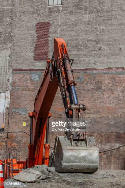 backhoe on a construction site - eric van den brulle stock pictures, royalty-free photos & images
