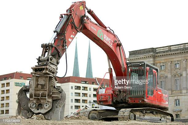 Backhoe stands on the construction site of the Berliner Schloss city palace in front of the St.-Nikolai-Kirche, or St. Nicholas Church, on June 12,...