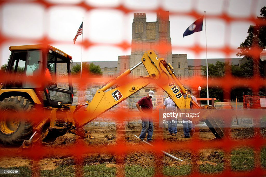A backhoe works on the permanent memorial for the victims of a shooting rampage that left 32 dead on the campus of Virginia Tech June 14, 2007 in Blacksburg, Virginia. On April 16, 2007, Virginia Tech undergraduate student Hsung-wei Cho went on a shooting rampage on the second floor, killing 30 of his 32 victims while they were attending or teaching engineering and language classes in Norris Hall. Virginia Tech President Charles Steger said the June 18 reopening of Norris Hall is the best way for the College of Engineering and the Department of Engineering Science and Mechanics to heal and move forward. No general assignment classes will be held in Norris, but the 70,000-square-foot building will be used for offices and laboratories. The classrooms where the shootings happened will remain closed.