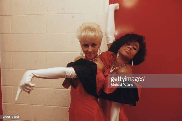 Backing singers Pepsi and Shirlie, performing with pop duo Wham!, pictured backstage together in Australia during 'The Big Tour' in January 1985....