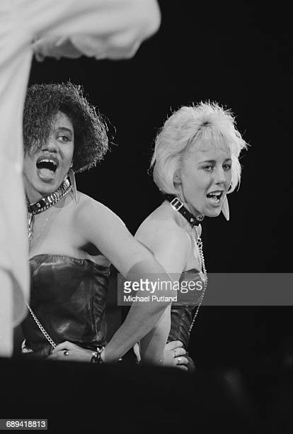 Backing singers Pepsi and Shirlie, performing with pop duo Wham! Wham!, during 'The Big Tour', Japan, 1985. Left to right: Helen DeMacque and Shirlie...