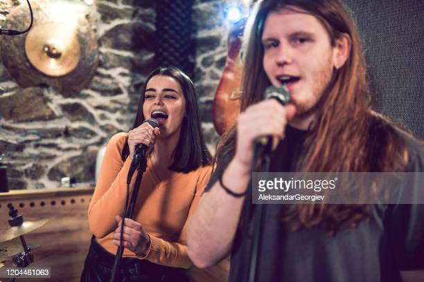 backing singers performing their line in studio - amateur stock pictures, royalty-free photos & images