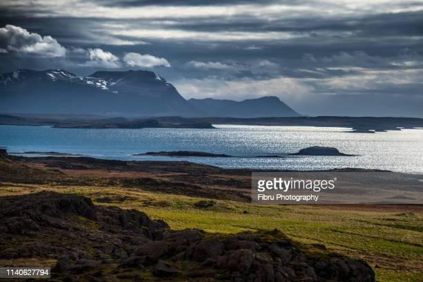 backlight  coast view in snaefellsnes peninsula - austurland stock-fotos und bilder