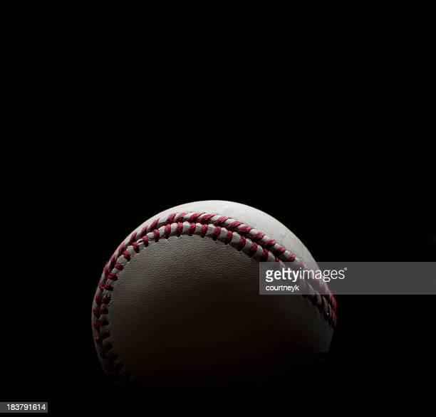 Backlit Baseball shot on a black background
