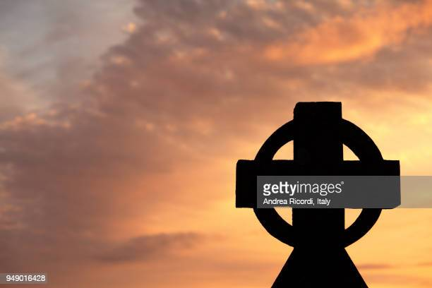 Backlit celtic cross at sunset