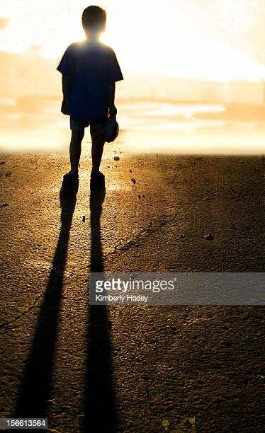 Backlit child and shadow