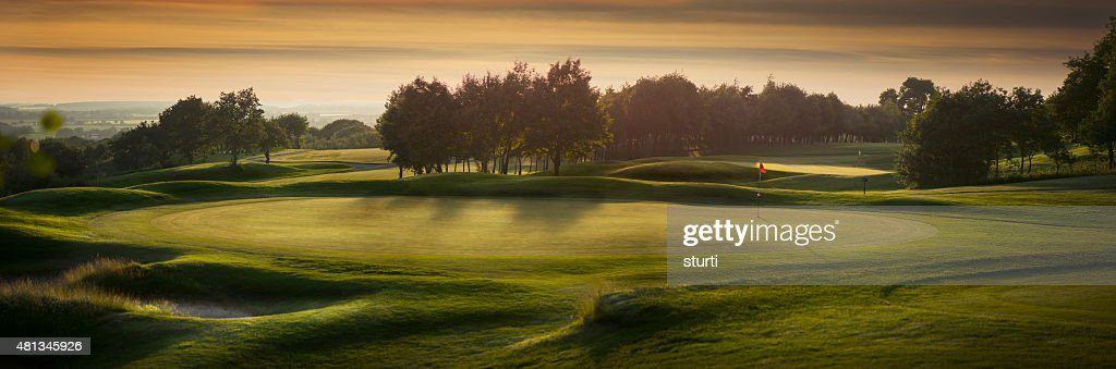 backlit golf course with no golfers : Stock Photo