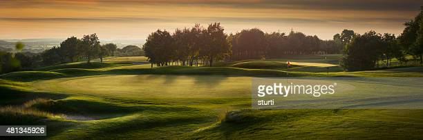 backlit golf course with no golfers - golf flag stock photos and pictures