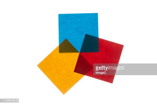 backlit multi colored paper - three objects stock pictures, royalty-free photos & images