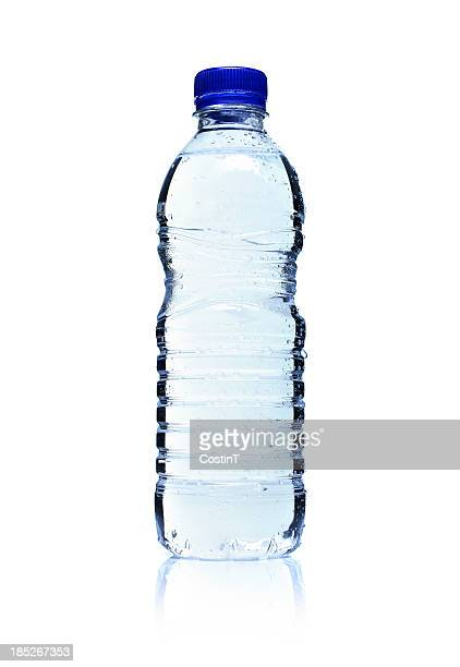 backlit plastic water bottle. isolated on white. - fles stockfoto's en -beelden