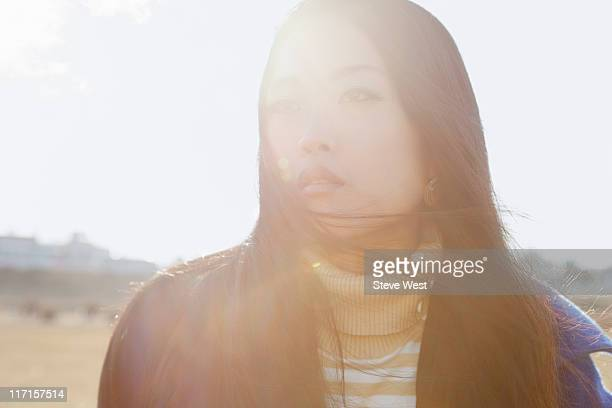 Backlit portrait of young Asian woman