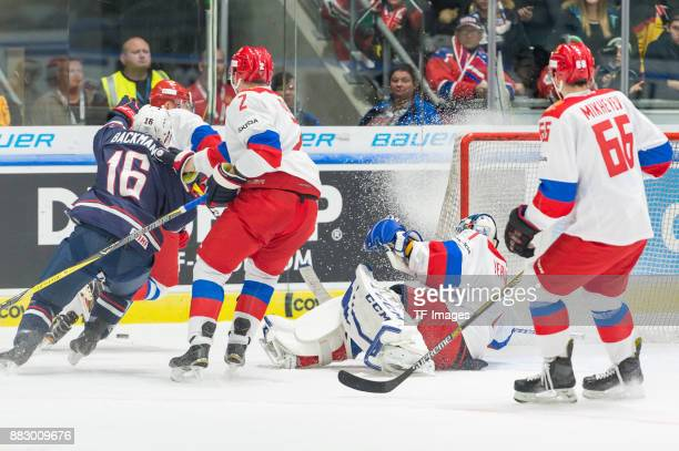 Backman of USA Pavel Koledov of Russia Alexander Yeryomenko of Russia and Ilya Mikheyev of Russia battle for the ball during the Deutschland Cup 2017...