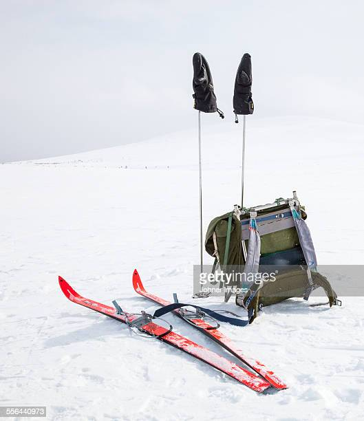 Backpack and skis on snow