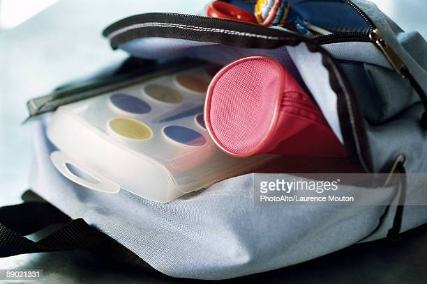 Backpack containing pencil case and watercolor paints