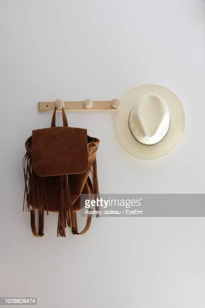 Backpack Hanging By Hat At Home