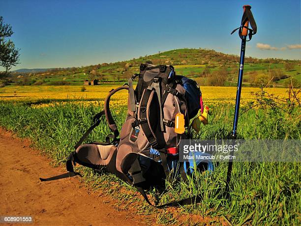 Backpack On Grassy Landscape Against Clear Sky