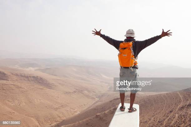 backpacker adventure in desert mountains. - israeli men stock photos and pictures