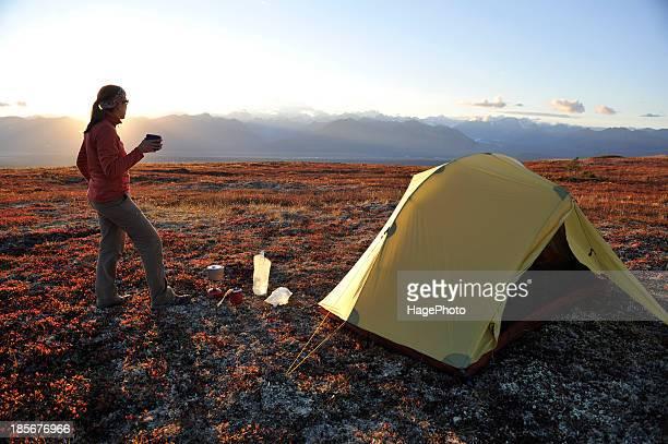 Backpacker camping on Kesugi Ridge Trail in Denali State Park, Alaska.
