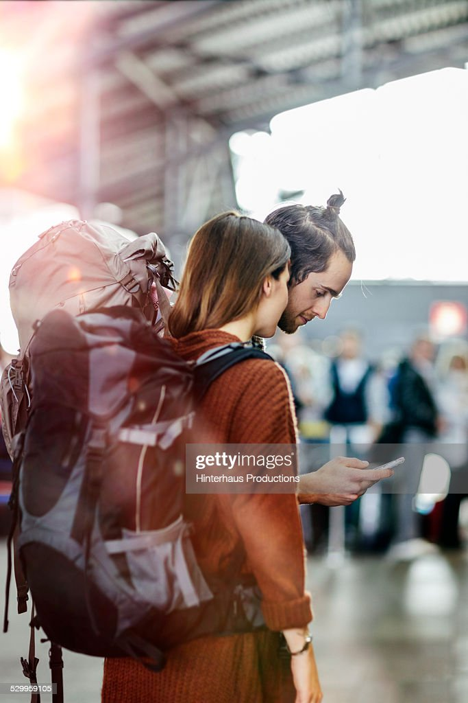 Backpacker Couple At The Airport : ストックフォト