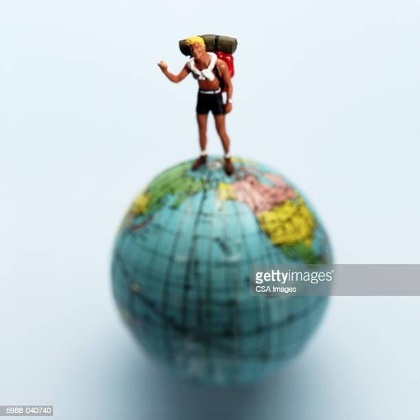 Backpacker Doll on Globe