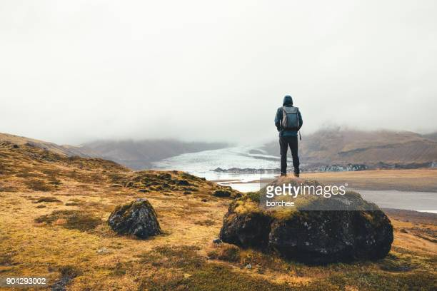 Backpacker Enjoying The View On Vatnajokull Glacier In Iceland
