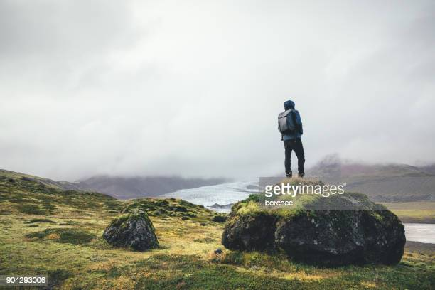 backpacker enjoying the view on vatnajokull glacier in iceland - wilderness stock photos and pictures