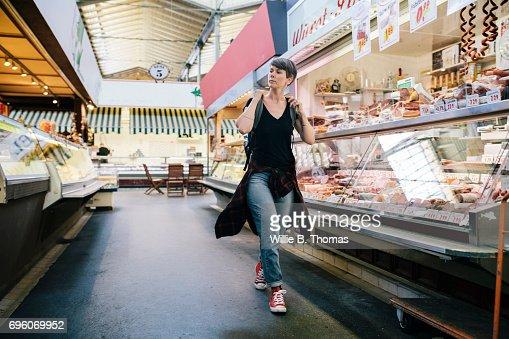 Backpacker Exploring An Indoor Market