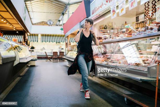 Backpacker Exploring An Indoor Market
