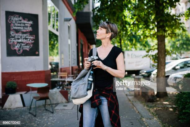 backpacker exploring the streets with her camera - 7894 stock pictures, royalty-free photos & images