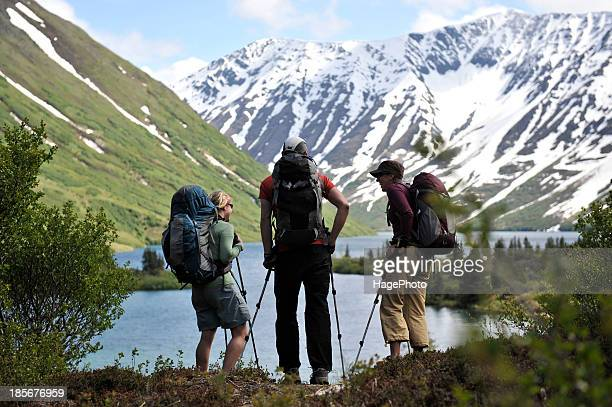 Backpacker hiking at Crescent Lake in Chugach National Forest Southcentral Alaska.