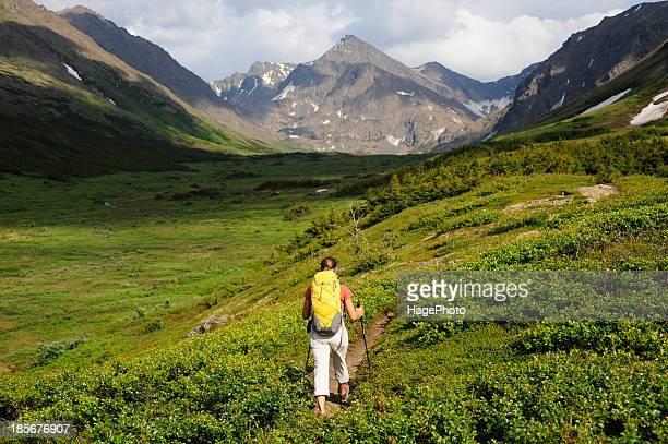 Backpacker hiking in Chugach State Park near Anchorage, Alaska.