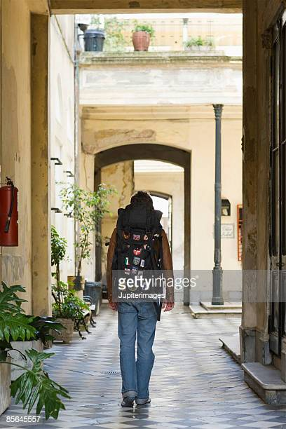 Backpacker in tiled courtyard