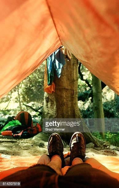 Backpacker inside tarp tent