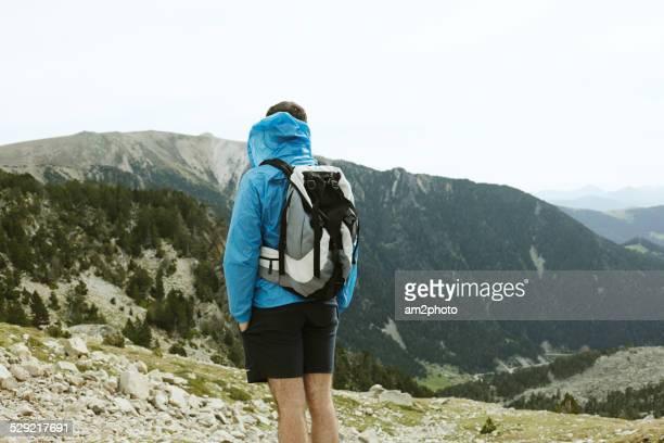 A backpacker is hiking