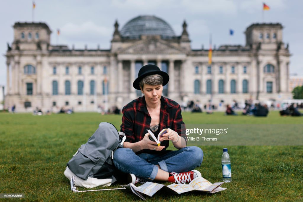 Backpacker Sitting In Front Of Bundestag : Stock Photo