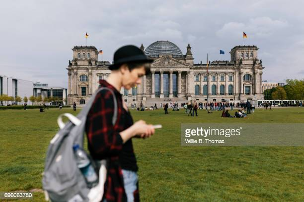 Backpacker Standing In Front Of A Bundestag