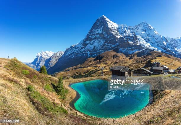 backpacker take a photo of jungfrau peak, top of europe, at kleine scheidegg, switzerland - switzerland stock pictures, royalty-free photos & images